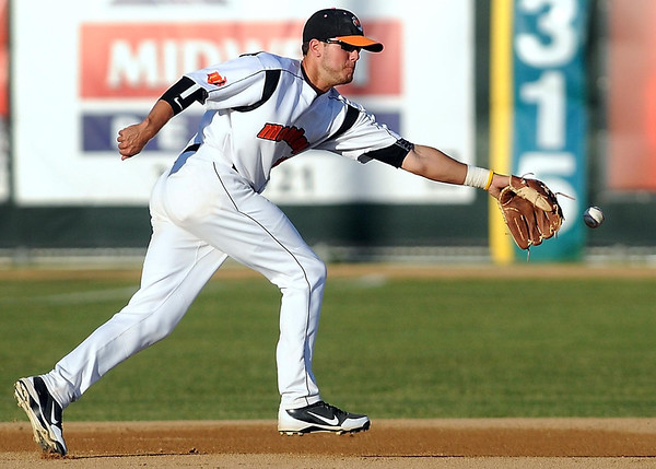The ball slips past the outstretched glove of Mankato MoonDogs third baseman Trey Nielsen during their game against the Alexandria Beetles Wednesday at Franklin Rogers Park.