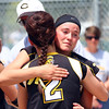 East's Savannah Quandt gives Hailey Oelke a tearful hug after Friday's third place game loss to Orono.