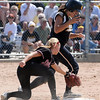 Mankato East's Rebekah Kolstad gets to second base ahead of the tag during their State Class AAA game against Stillwater Thursday at Caswell Park.