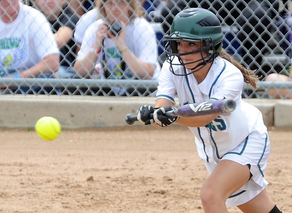 Maple River's Erica Hengel lays down a bunt during their State Class AA game against Albany Thursday at Caswell Park.
