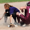 New Ulm Cathedral's Anne Schwarz slides safely into second base as Red Lake Falls' Kayla Schmitz drops the ball during their State Class A game Thursday at Caswell Park.