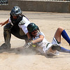 Maple River's Erica Hengel is tagged out in a play at the plate by Cloquet's catcher Jade Benko.