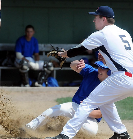 John Cross<br /> Mankato's David Gullickson scores on a passed ball as Lake Crystal pitcher Mitch Kelley waits for the throw during third inning action at Lake Crystal, Saturday.