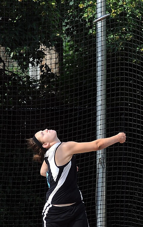St. Clair's Ashley Thooft throws the discus during the State Class A track and field meet Friday.