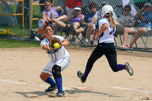 Maple River's Joanne Trio makes the out at first base just before Cloquet's Kayla Masessa arrives.