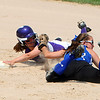 New Ulm's Jill Gareis slides past Saint Anthony Village's short stop Mary-Clare Couillard.