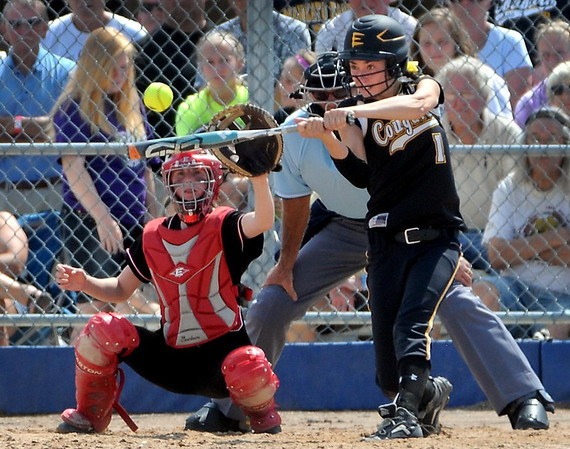 Mankato East's Coley Ries hits an RBI single during their State Class AAA game against Stillwater Thursday at Caswell Park.