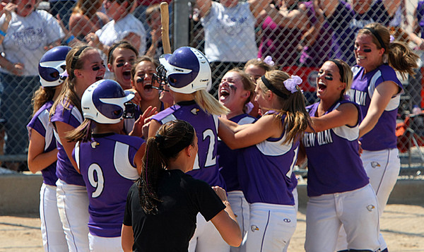 New Ulm celebrates at home plate after a home run hit by Brittany Hoffmann.