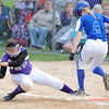 Pat Christman<br /> New Ulm's Ellie Schneider stretches to touch first base before Kasson-Mantorville's Hanna Sheeran during their State Class AA championship game Friday at Caswell Park.