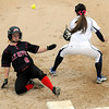 John Cross<br /> Elk River's Marie Deaton safely steals third ahead of a throw to Prior Lake's Sam Buhman during the Class AAA Championship Friday at Caswell Park.