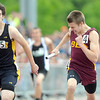 Pat Christman<br /> Blue Earth Area's Nick Beattie, right, edges out Byron's Ricky Brown to win the boys 4x200 meter relay at the State Class A track and field meet Saturday in St. Paul.
