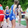 Pat Christman<br /> Waseca's Allison Breck races Benson/Kerkhoven-Murdock-Sundberg's Emily Tostenson to the next handoff during the girls 4x800 meter relay finals Saturday in St. Paul. Benson/KMS edged Waseca to take the state championship.