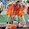Pat Christman<br /> Madelia/Truman's DaMarko Thomas makes snow angels on the Hamline University turf as teammates, from left, Jon Whitney, Adam Cooling and Cade Eckstrom celebrate their boys 4x400 meter relay State Class A championship Saturday in St. Paul.