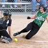 Pat Christman<br /> New Life Academy's Theresa Baranick slides into home as the ball reaches Blooming Prairie catcher Sam Ivers during the fourth inning of their State Class A championship game Friday at Caswell Park.