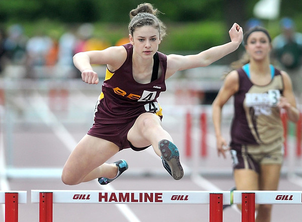 Pat Christman<br /> Blue Earth Area's Taylor Grandgenett clears the final hurdle on her way to winning the girls 300 meter low hurdles championship at the State Class A track and field meet at Hamline University in St. Paul.