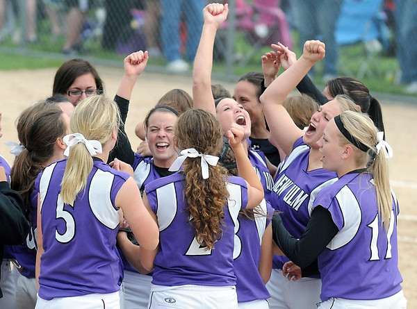 Pat Christman<br /> New Ulm players celebrate their 1-0 win over Kasson-Mantorville in the State Class AA championship game Friday at Caswell Park. It is the second consecutive championship for the Eagles.