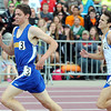 Pat Christman<br /> Waseca's Shane Streich looks over his shoulder at St. Cloud Cathedrals' Nick Golebiowski on the home stretch of the 1600 meter run finals at the State Class A track and field meet Saturday at Hamline University in St. Paul.