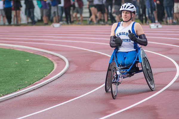 Aidan Gravelle of LCWM-Nicollet cheers on fellow wheelchair athlete James Hagen of Sleepy Eye Unified after completing the 200 meter dash. Gravelle finished in second place with a time of 19.85 seconds. Photo by Jackson Forderer