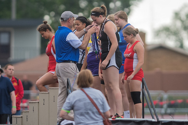 Megan Mettler of St. Clair stands on the podium after receiving her ninth-place medal for girls shotput  at the Class A state track and field meet. Photo by Jackson Forderer