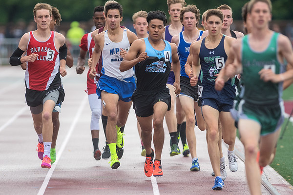 Hugo Ruiz (4) of Tri-City runs in the middle of the pack during the 1600 meter race at the Class A state track meet. Ruiz finished in eighth place with a time of 4 minutes and 29.93 seconds. Photo by Jackson Forderer