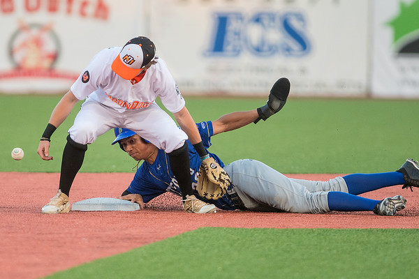 Waterloo's Drue Galassi watches the MoonDogs' Cole Pengilly try to recover the ball as Galassi stole second base. Photo by Jackson Forderer