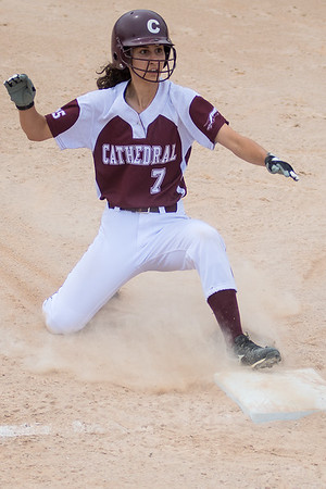 Sarah Mohr of New Ulm Cathedral slides safely into third base. Photo by Jackson Forderer