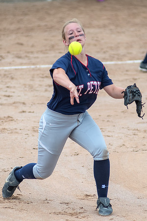 St. Peter's Alexandra Zachman makes a throw to first, forcing a Maple Lake runner out in the Class AA state championship game. Photo by Jackson Forderer