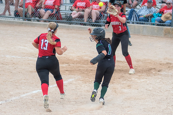 Park's Emma Ambroz (1) gets caught in a rundown between Centennial's Alyssa Montero (3) and Hannah Hudson (13) along the third base line during Thursday's semifinal game. Park won the game 10-0 played at Caswell Park in Mankato, Minn. on June 7, 2018. The Wolfpack will play Stillwater for the state championship. (Jackson Forderer/Special to the Pioneer Press)
