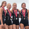 The Waterville-Elysian-Morristown girls 4x100 meter relay team, from left, Toryn Richards, Shelby Hermel, MaeLea Harmon, Alexis Morsching, stand on the podium with their second place medals at the Class A state track meet. The team finished with a time of 50.30 seconds. Photo by Jackson Forderer