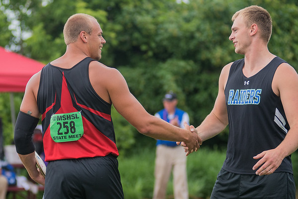 Mitch Weber (left) of St. Clair shakes hands with Samuel Moore of Bertha-Hewitt/Verndale at the conclusion of the discus event at the Class A state track and field meet. Weber took first place in the event with a throw of 185 feet and 8 inches, and Moore took second place with a throw of 170 feet and 4 inches. Photo by Jackson Forderer