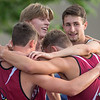 The Fairmont 4x400 meter relay team huddles near the finish line after taking second place in the event with a time of 3 minutes and 24.38 seconds. Photo by Jackson Forderer