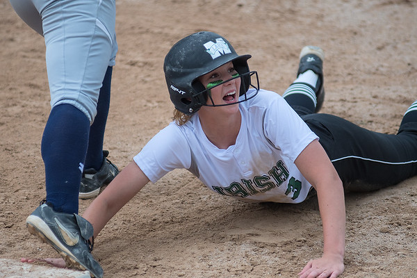 Maple Lake's Amber Klug is shocked by the umpire's decision, calling her out at first base after the St. Peter defense doubled her up after catching a line drive. Photo by Jackson Forderer