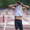 Jade Reicks of St. Peter shows his disappointment after falling over the last hurdle of the 300 meter hurdle race. Reicks finished in ninth place with a time of 41.38 seconds. Photo by Jackson Forderer