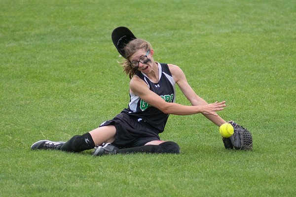Isabella Brockhouse of Badger/Greenbush-Middle River comes up short on making a diving catch in center field in a quarterfinal game against New Ulm Cathedral. Photo by Jackson Forderer