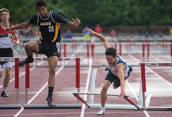 Jade Reicks of St. Peter falls over the last hurdle in the 300 meter hurdle race at the Class A state track meet held at Hamline University on Saturday. Reicks ended up finishing in ninth place with a time of 41.38 seconds. Photo by Jackson Forderer