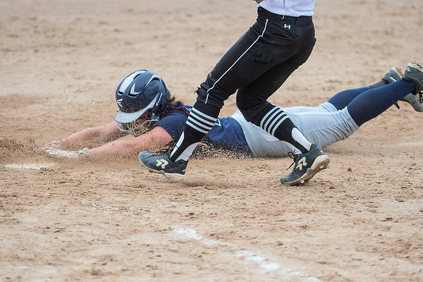 St. Peter's Olivia McCabe slides across home plate in what would be the Saints only run against Maple Lake in the Class AA championship softball game. The Saints lost 11-1 against Maple Lake but took second place in the Class AA state tournament. Photo by Jackson Forderer