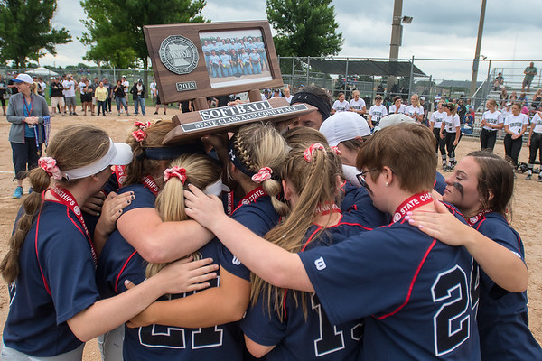 The St. Peter softball team huddles after receiving the second place trophy for the Class AA state softball tournament. Photo by Jackson Forderer