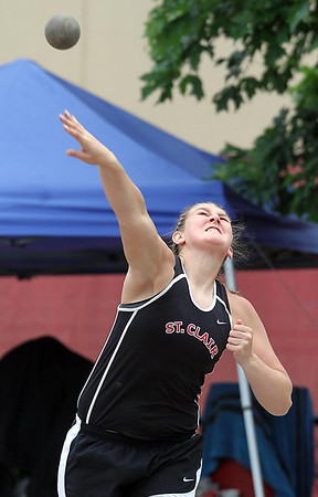St. Clair's Katelyn Weber throws during the shot put finals at the Class A track and field meet Saturday in St. Paul. Weber won the event. Photo by Pat Christman