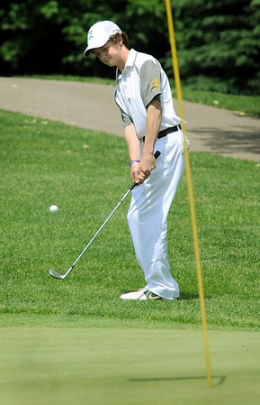 Carson Haley chips onto a green during the Class AA State Golf Tournament at the Ridges at Sand Creek golf club in Jordan on Tuesday. Photo by John Cross