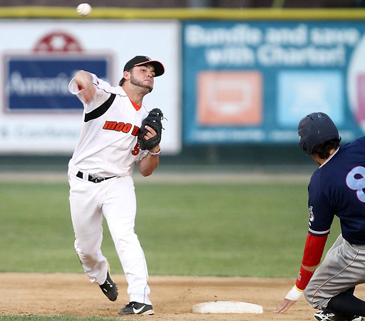 Mankato MoonDogs' Brett Synek turns a double play during the fifth inning againsta the St. Cloud Rox Wednesday at Franklin Rogers Park. Photo by Pat Christman
