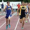 Waseca's Shane Streich keeps an eye on Perham's Keeghan Hurley as they race the last 75 meters of the 1600 meter run at the State Class A track and field meet Saturday at Hamilne University. Streich beet Hurley by .16 seconds and set a new state record. Photo by Pat Christman