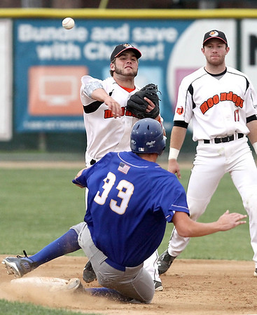 Mankato MoonDogs' Justin Fletcher (17) watches as teammate Brett Synek gets the first out of a double play during the fourth inning against Waterloo Friday at Franklin Rogers Park. Photo by Pat Christman