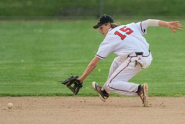 Mankato West shortstop Kyle Looft goes after a ground ball during the Scarlets game against Marshall. West won the first game of the Section 2AAA championship round 10-3, but will need to defeat Marshall again to advance to the state tournament. Photo by Jackson Forderer