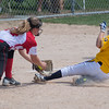 Mankato West's Kenzie Grunst tags out Totino-Grace's Lauren Scheneman (3) at third base in the Class AAA third place game played at Caswell Park on Friday. Photo by Jackson Forderer