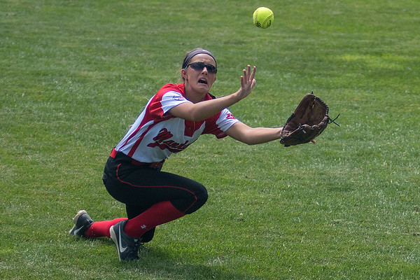 Mankato West's right fielder Tristin Danay goes after a fly ball hit by a Totino-Grace player in the third place game played at Caswell Park on Friday. The Scarlets lost 8-1 to Totino-Grace and finished in fourth place at the state tournament. Photo by Jackson Forderer