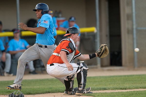 MoonDogs catcher Justus Nelson (right) gets a throw a fraction too late to make a tag attempt on St. Cloud Rox's Eric Feliz in a Northwoods League game played on Tuesday. Photo by Jackson Forderer
