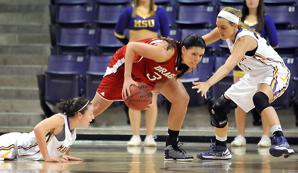Minnesota State-Moorhead's Leah Miller recovers a loose ball while surrounded by Minnesota State's Alli Hoefer (left) and Jamie Bresnahan during the first half of their NSIC tournament quarterfinal game Saturday at Bresnan Arena.