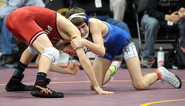 Lake Crystal-Wellcome Memorial's Louie Sanders wrestles Pierz's Brandon Sullivan during their State Class A 120 pound quarterfinal match Friday.