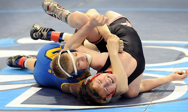 Le Sueur-Henderson's Austin Anderly goes for the pin against New Richland-Hartland-Ellendale-Geneva's Cordell Peterson during their State Class A 106 pound quarterfinal match Friday. Anderly won the match.