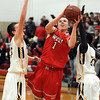 Mankato West's Jake Dale (1) drives between Mankato East's Matt Bornholdt (left) and Mattu Choul during the first half Wednesday at the West gym.